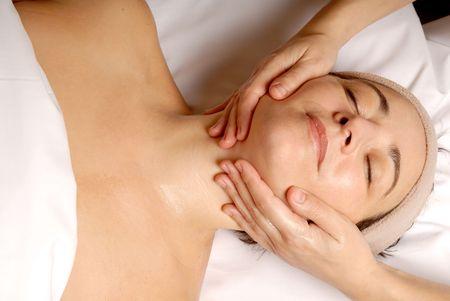 얼굴 표정: female getting a facial treatment at a spa 스톡 사진