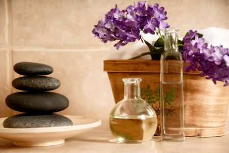 day spa products with stones, oil container, flowers photo