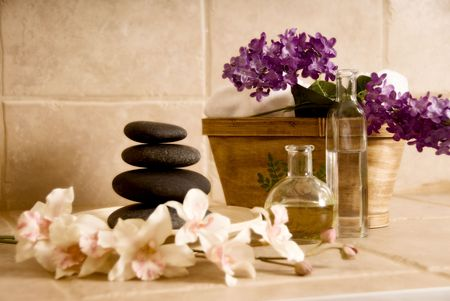 day spa products like lastone stones, flowers and oil photo