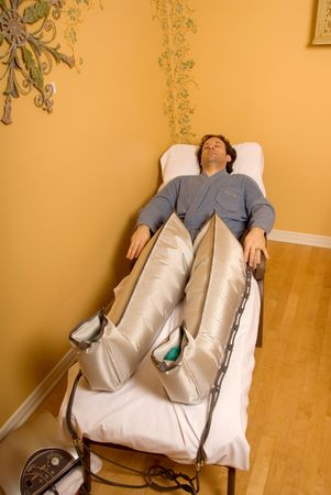 man in a spa with pressotherapy legs on Stock Photo - 693760