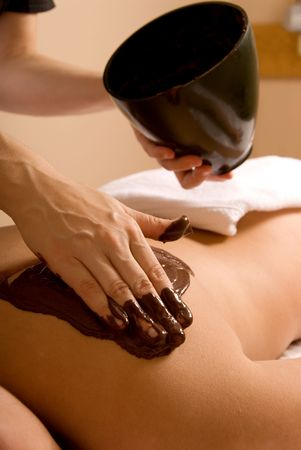 holistic therapy: woman receiving cacao therapy in a spa