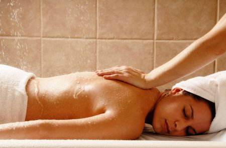 Woman getting a water massage in a day spa Stock Photo - 692728
