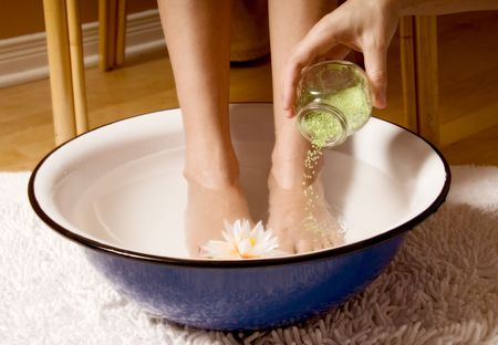 woman in foot bowl at a spa