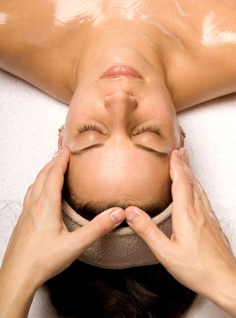 woman getting a head massage with cream in a spa Stock Photo - 692734