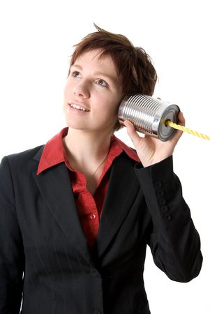 tin can: woman in a suit listening to a tin can phone