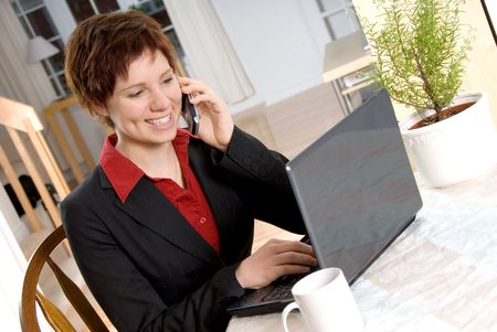 woman in a suit on the cell phone with laptop photo