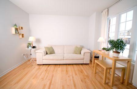 베이지 색 소파가있는 현대적인 거실 스톡 콘텐츠