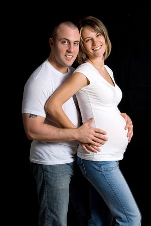 happy young couple with pregnant belly on black Stock Photo - 717292