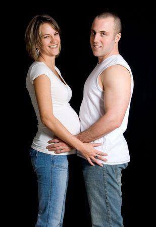 expecting couple holding on black background Stock Photo - 717287