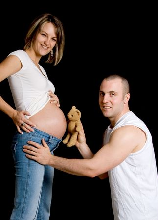 couple with their teddy bear looking at camera Stock Photo - 717282
