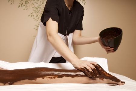 cute woman getting a cacao treatment at a spa Stock Photo - 729425