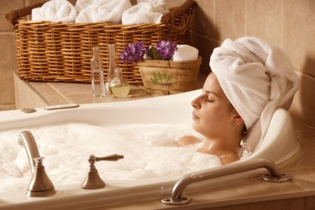 cute girl with a towel on her head in a bath Stock Photo