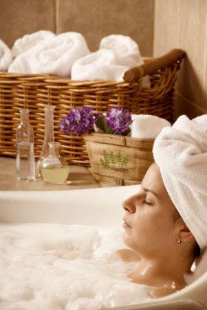 cute woman in a bath in a local spa photo