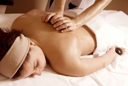 woman in a day spa with stone massage Stock Photo - 729418