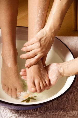 pedicure: woman getting a foot massage with some cream