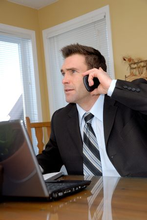 man in a suit and tie talking on the phone Stock Photo - 743051