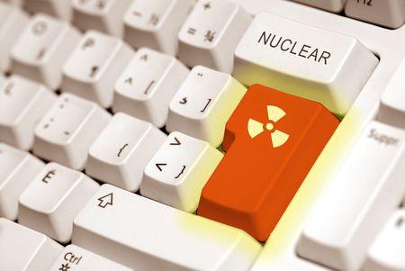 plutonium: radioactive button on a keyboard computer in orange