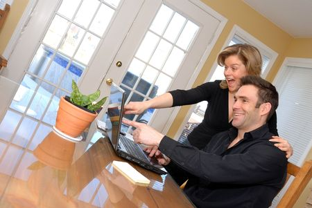 cute happy couple on the internet on the laptop Stock Photo - 770749