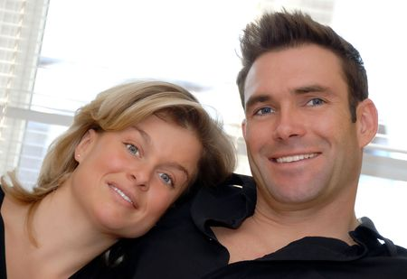 happy couple in love with woman leaning on shoulder Фото со стока