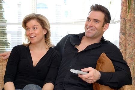 cute couple on the couch watching the TV Stock Photo - 770932