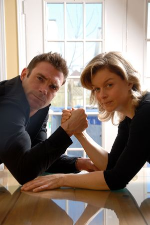 man and a woman ready to arm wrestle photo