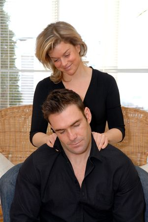 massaging: Woman giving a massage to her lovely man
