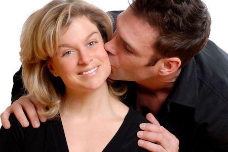 man kissing cute blond on the cheek
