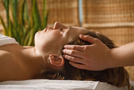 woman in a day spa getting a head massage with green plant Stock Photo - 809669