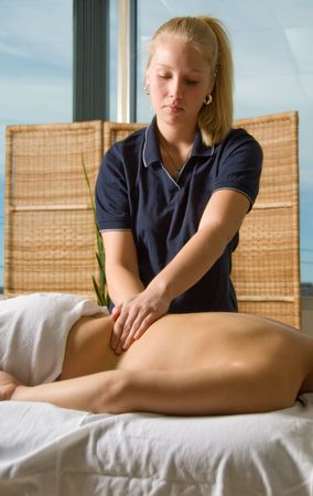 woman in a day spa getting a head massage by therapist Stock Photo