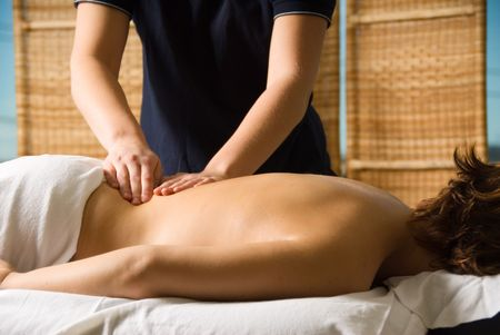 woman in a day spa getting a good massage