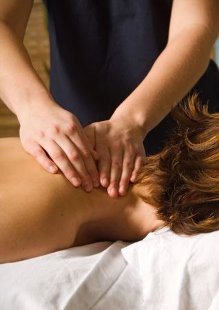 woman in a day spa getting a neck massage  Stock Photo
