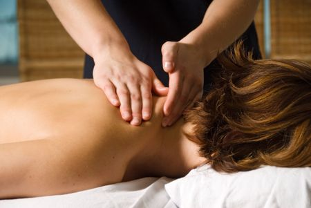 woman in a day spa getting a neck massage