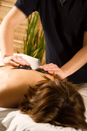 woman in a day spa getting a hot stone massage Stock Photo - 809679