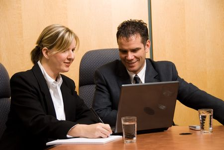 business colleagues in a borad room with a laptop Stock Photo