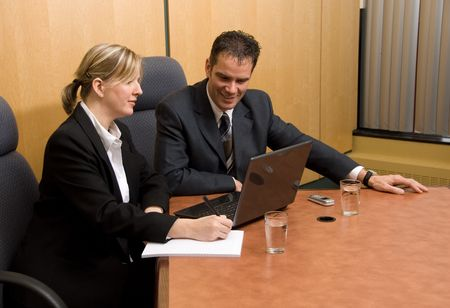 business colleagues in a borad room with a laptop Stock Photo - 820215