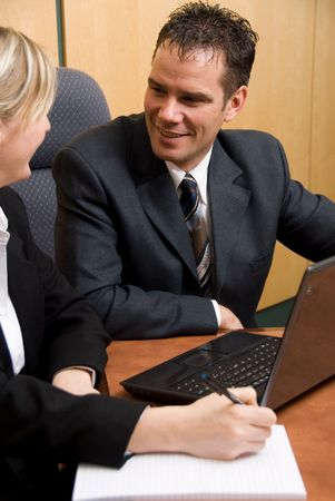 business colleagues in a borad room with a laptop Stock Photo - 820217