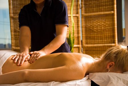 woman at a day spa getting a nice back massage