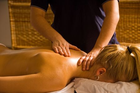 blond woman at a day spa getting a massage Stock Photo