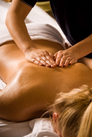 woman at a day spa getting a relaxation massage