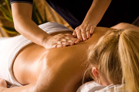 retreats: woman at a day spa getting a back massage Stock Photo