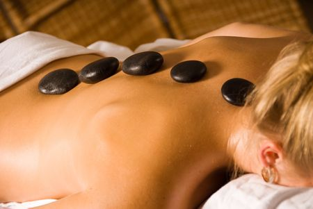 blond woman at a day spa with hot stones Stock Photo - 823064