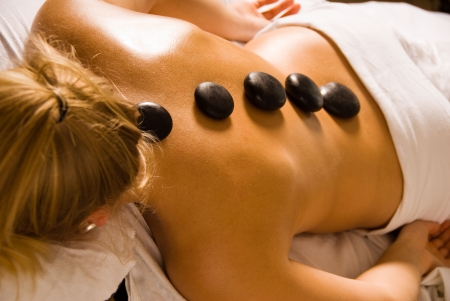 blond woman at a day spa with hot stones Stock Photo - 823065