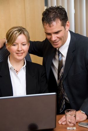 man and woman in a business room with a laptop Stock Photo - 848195