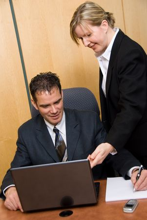 man and woman in a room with a laptop writing on paper Stock Photo - 848199