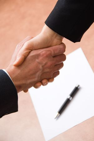 2 hands shaking with a blank contract and pen Stock Photo - 848207