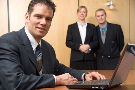 3 people looking at the camera with a laptop Stock Photo - 848217