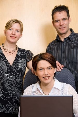 3 business people at the office with a laptop Stock Photo - 873097