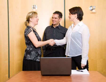 three business colleagues in a boardroom in a meeting Stock Photo - 881746