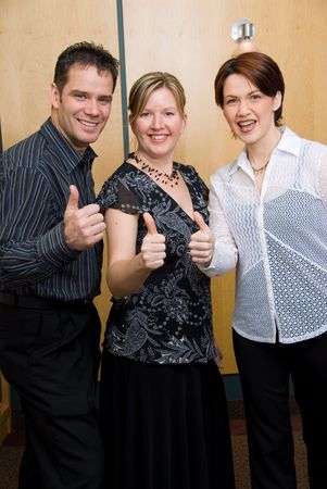 3 colleagues with their thumbs up photo