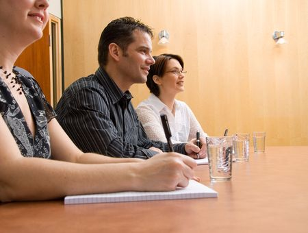 business people writing in a meeting room photo